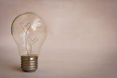 Coeurs d'amour à l'intérieur de blub léger Images stock