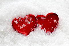 Coeurs d'amour dans la neige Photo stock