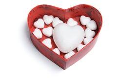 Coeurs d'amour dans le cadre de cadeau Images stock