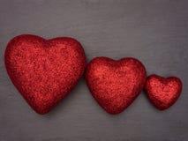 Coeurs d'amour disposés comme un groupe de famille Photo stock