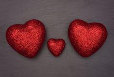 Coeurs d'amour disposés comme un groupe de famille Photo libre de droits