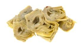 Coeurs d'artichaut marinés sur un fond blanc photo stock