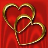 Coeurs d'or sur la soie rouge Photo libre de droits