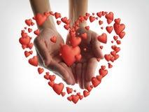 Coeurs dans des mains Images libres de droits