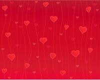 Coeurs dans le fil, fond rouge Photos stock