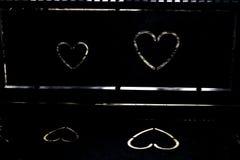 Coeurs dans le léger et foncé Photos stock
