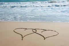 Coeurs dans le sable Photographie stock libre de droits