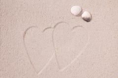 Coeurs dans le sable et les interpréteurs de commandes interactifs Photos stock