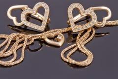 Coeurs de bijoux d'or Photographie stock