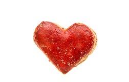 Coeurs de biscuits en glaçage rouge d'isolement Images libres de droits