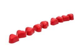 Coeurs de bonbons au chocolat rouges Photo stock