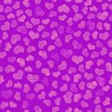 Coeurs de broderie d'or sur le fond violet image stock