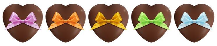 Coeurs de chocolat avec l'arc d'isolement sur le blanc Image stock