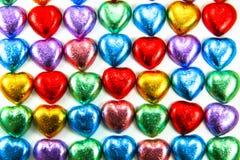 Coeurs de chocolat dans une ligne Photographie stock