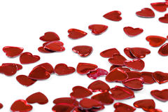 Coeurs de confettis sur le fond blanc Image libre de droits