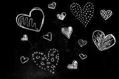 Coeurs de craie de dessin Photographie stock
