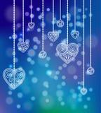 Coeurs de découpe sur le fond bleu Photographie stock libre de droits