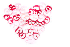 Coeurs de papier dans la forme du coeur sur le fond blanc Photo stock