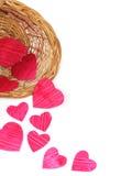 Coeurs de papier dans un panier Photographie stock
