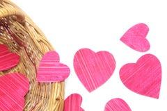Coeurs de papier dans un panier Photo stock