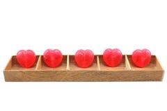 Coeurs de sucrerie dans la boîte en bois Photos stock