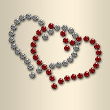 Coeurs de Valentine de diamant sur le satin Photos libres de droits