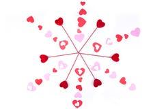 Coeurs de Valentine sur des bâtons avec des formes de coeur Photos stock