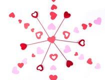 Coeurs de Valentine sur des bâtons avec des formes de coeur Image libre de droits