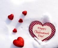6 coeurs de valentines dans la neige Images libres de droits