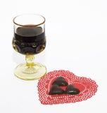 Coeurs de vin et de chocolat Image stock