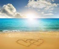 Coeurs dessinés en plage Photographie stock libre de droits