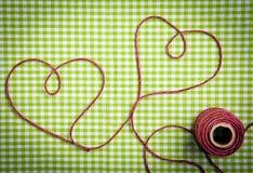 Coeurs dessinés par filé pourpré Photo libre de droits