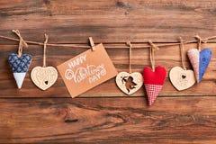 Coeurs et carte sur la corde Photos libres de droits
