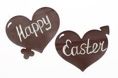 Coeurs heureux de Pâques d'inscription sur un fond blanc Images stock
