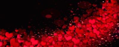 Coeurs lumineux sur un fond noir Image libre de droits