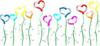 Coeurs multicolores sur des tiges sous forme de fleurs Photos stock