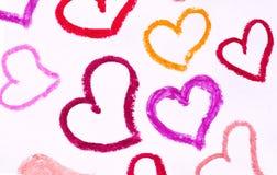 Coeurs peints avec différentes nuances de rouge à lèvres, Photo stock