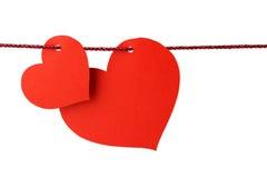 Coeurs pendant d'une ficelle Photos libres de droits
