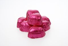 Coeurs roses de chocolat photographie stock