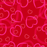 Coeurs roses sur un fond rouge photos libres de droits