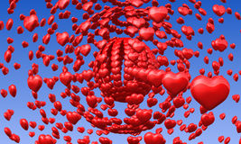 Coeurs rouges d'amour en ciel bleu Photographie stock