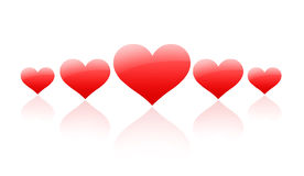 Coeurs rouges dans une ligne Photo stock