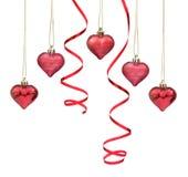 Coeurs rouges de babiole de Noël Images stock