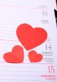 Coeurs rouges pour le jour de valentines sur le calendrier Photo stock
