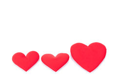 Coeurs rouges sur le fond blanc Photographie stock