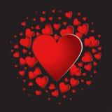 Coeurs rouges sur le fond noir Photographie stock