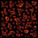 Coeurs rouges sur le noir Photo stock