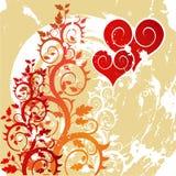Coeurs rouges sur un ornement de fleur Photographie stock libre de droits