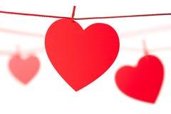 Coeurs s'arrêtant sur la corde Photo libre de droits