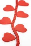 Coeurs sur la corde tressée Images libres de droits